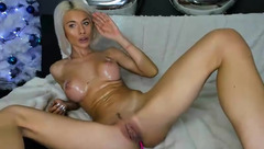 Slender Bday_Jelisse is oiling up round silicon tits and fingering pussy while webcam sex chat