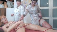 Two dirty lesbian masseurs tied slender shaped XVictoria on massage couch and stroking her pussy