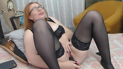Brown haired milf IvettaShine with glasses and black stockings is enjoying masturbating cunt