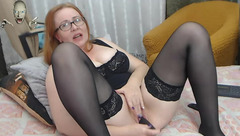 Brown haired plump IvettaShine in hot black lingerie is enjoying posing to the webcam and masturbating twat