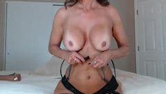Tight and slender shaped curly mature JessRyan is hotly undressing and showing big boobs and bubble butt