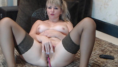 Tight and hot blonde milf AlexaXCharm is wide spreading legs to show off her twat to the webcam
