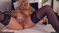 Juicy hot blonde AlysaHerrera in black stockings is excitingly posing to the webcam and stroking shaved pussy