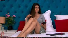 Beautiful webcam girl Carinarise is hotly posing to the webcam in steaming hot light dress