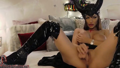 Awesome sexy shaped devil babe Natalielynn in black boots is masturbating cunt with rubber cock