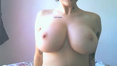Webcam babe ValSantos is undressing in front of the webcam and showing off big juicy boobs
