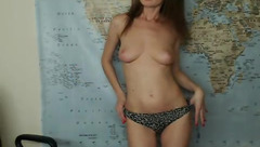 Brown haired skinny Nicole Color is undressing in front of the webcam and masturbating with sex toy