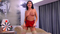 Black busty girl in hot red nylon bodysuit is posing t the webcam and sucking big dildo
