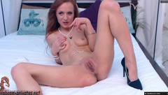 Skinny milf Amalielove is taking off sexy underwear and stroking shaved pussy and small saggy boobs