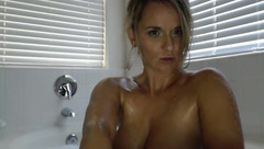 Appetizing tight MissMayah is taking bath and stroking tits and cunt in front of the webcam