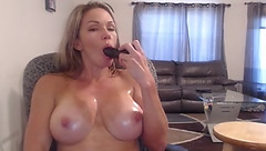 Alluring sexy blonde milf Fitchick69 with big juicy tits is sucking big dildo and masturbating