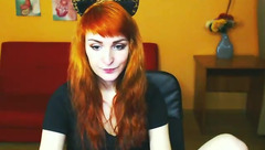 Ginger Roxy Diaz is undressing and masturbating cunt on webcam sex chat