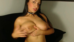 Brunette with huge tight boobs Sussie Moore is posing to the webcam nude and masturbating pussy