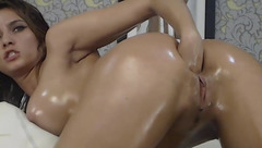 Big-boobed cam girl AngelKiuty fists her lubed ass for a bit