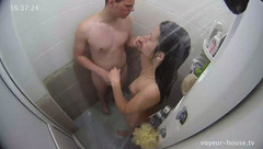 Charming sexy brunette is taking shower with boyfriend and shaving her cunt